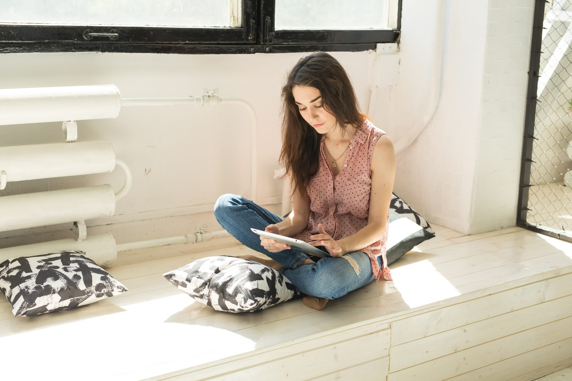 people technology and internet concept young woman using digital tablet at home